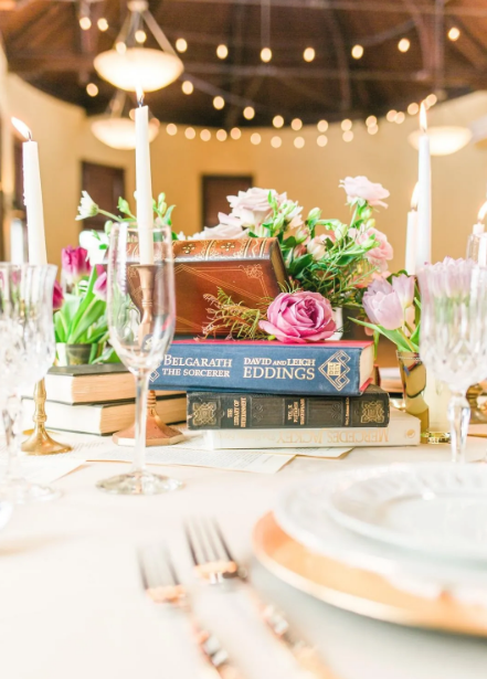 Books, Candles and Pink Roses Centerpiece