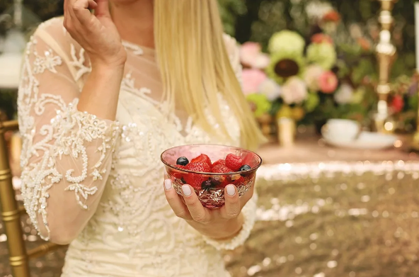 Lace wedding gown and berries
