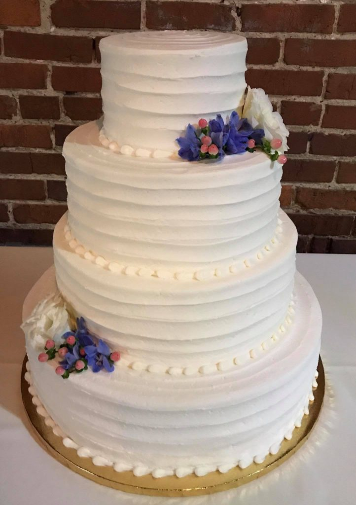 Wedding Cake with Purple flowers - The Rolling Pin